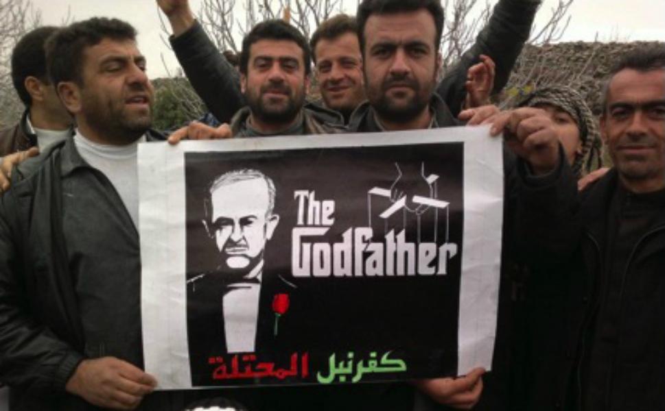 Асад изображён в виде дона корлеоне из